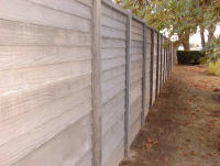 "Close-up of ""wood"" fence in charcoal gray color"